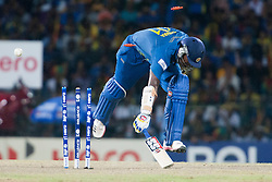 © Licensed to London News Pictures. 07/10/2012. Sri Lankan Thisara Perera gets run out  during the World T20 Cricket Mens Final match between Sri Lanka Vs West Indies at the R Premadasa International Cricket Stadium, Colombo. Photo credit : Asanka Brendon Ratnayake/LNP