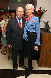 Actor and Oscar winning screenwriter JULIAN FELLOWES and his wife EMMA KITCHENER-FELLOWES at a party to celebrate the opening of Maze - a new Gordon Ramsay restaurant at 10-13 Grosvenor Square, London W1 on 24th May 2005.<br />