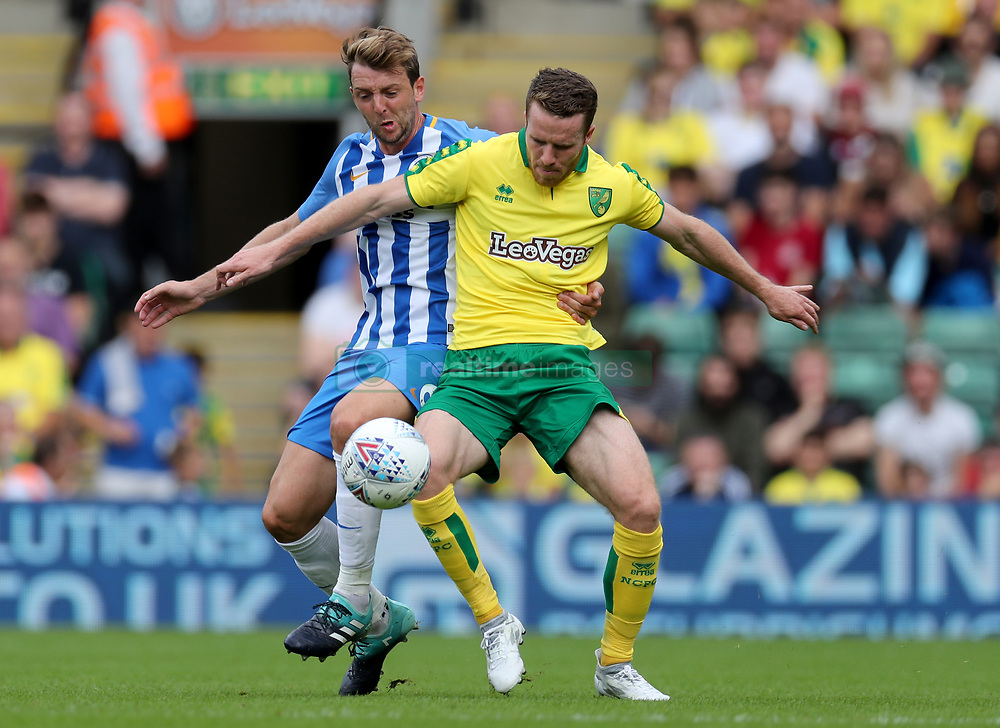 Norwich City's Marley Watkins (right) is challenged by Brighton's Dale Stephens during the pre-season match at Carrow Road, Norwich.