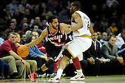 Feb. 5, 2011; Cleveland, OH, USA; Portland Trail Blazers point guard Patrick Mills (8) drives around Cleveland Cavaliers power forward Samardo Samuels (24) during the second quarter at Quicken Loans Arena. Mandatory Credit: Jason Miller-US PRESSWIRE