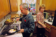 (MODEL RELEASED IMAGE). The next morning, Mark Bainton cooks breakfast; a task he performs every weekend morning, unless, of course, he can persuade his wife Deb to do it. Hungry Planet: What the World Eats (p. 142). The Bainton family of Collingbourne Ducis, Wiltshire, England, is one of the thirty families featured, with a weeks' worth of food, in the book Hungry Planet: What the World Eats.