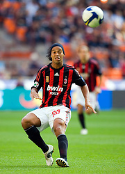 AC Milan's Brazilian forward Ronaldinho celebrates after scoring his second goal agaoinst Sampdoria during their Italian Serie A match on October 19, 2008 at San Siro Stadium in Milan.