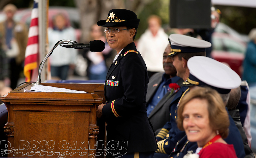 Guest speaker Col. Ranelle Manaois, left, 63rd Support Troop Commander, U.S. Army, jokes about being the shortest colonel -- at 4-foot, 11 inches -- in the U.S. armed services, at a Memorial Day service at Mountain View Cemetery in Oakland, Calif., Monday, May 25, 2015. (Photo by D. Ross Cameron)