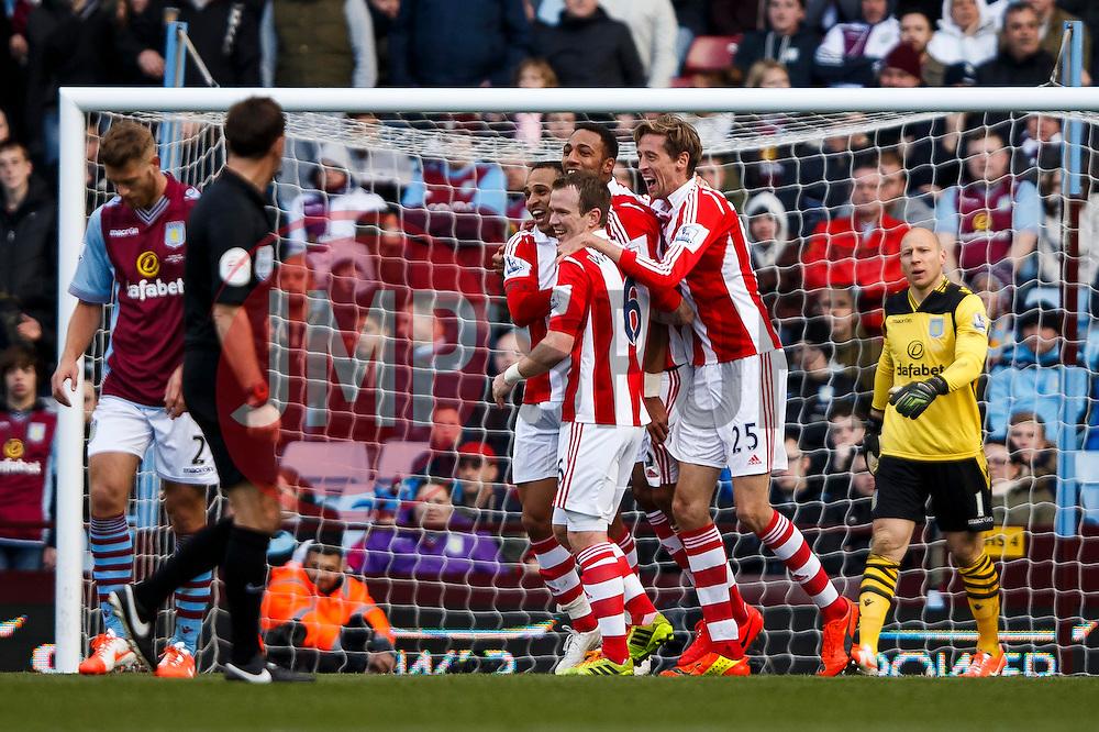 Stoke Midfielder Steven N'Zonzi (FRA) celebrates scoring a goal with his teammates - Photo mandatory by-line: Rogan Thomson/JMP - 07966 386802 - 23/03/2014 - SPORT - FOOTBALL - Villa Park, Birmingham - Aston Villa v Stoke City - Barclays Premier League.
