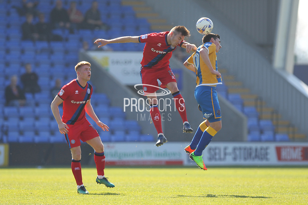 Matthew Lund competes for a header during the EFL Sky Bet League 1 match between Shrewsbury Town and Rochdale at Greenhous Meadow, Shrewsbury, England on 8 April 2017. Photo by Daniel Youngs.