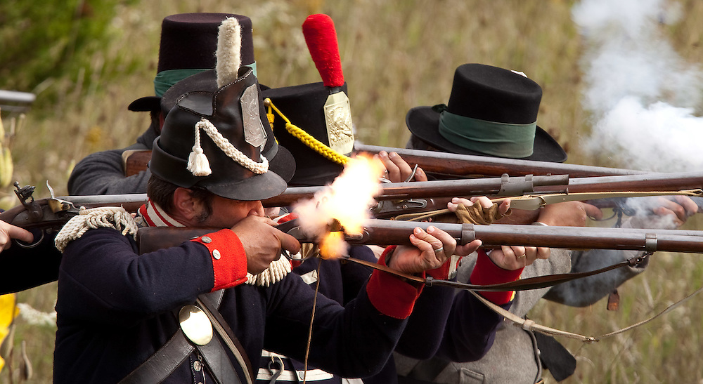 London, ONT.; October 1, 2011--  A line of American soldiers fire on the British during a War of 1812 re-enactment at Fanshawe Pioneer Village in London, Ontario, October 1, 2011.<br /> <br /> (GEOFF ROBINS/ Postmedia News)