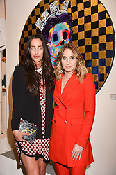 Left to right, sisters Lily Fortescue and Rosie Fortescue at a private view of work by Bradley Theodore entitled 'The Second Coming' at the Maddox Gallery, 9 Maddox Street, London England. 19 April 2017.