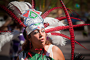 """10 OCTOBER 2010 - PHOENIX, AZ:  A Matachine dancer performs during a procession in Phoenix, AZ, Sunday. About 500 people processed through downtown Phoenix Sunday afternoon to honor the Virgin of Guadalupe, the """"Queen of the Americas."""" The procession was accompanied by 12 Matachine dance troupes. The Matachines are an important part of Mexican Catholic culture. They represent the battle of Good vs. Evil and the protect the Virgin from malevolent forces, represented by the demon like figures who accompany the dancers.      Photo by Jack Kurtz"""