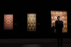 © Licensed to London News Pictures. 21/04/2017. London, UK.  A staff member views an Ottoman voided silk velvet and metal-thread panel (çatma), early 17th century, (est. GBP 40-60k), at a preview at Sotheby's, New Bond Street, of upcoming sales of Arts of the Islamic World, 20th century Middle East Art and Orientalist art. Photo credit : Stephen Chung/LNP