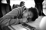 US rapper Roxanne Shante asleep on the Cold Chillin' tour bus, UK, 1988