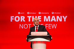 © Licensed to London News Pictures. 25/09/2017. Brighton, UK. Shadow Chancellor of the Exchequer and MP for Hayes & Harlington JOHN MCDONNELL speaks at the 2017 Labour Party Conference in Brighton. Photo credit: Hugo Michiels/LNP