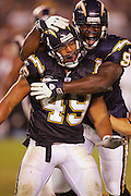 SAN DIEGO - SEPTEMBER 1:  Defensive end Robert Pollard #94 of the San Diego Chargers congratulates teammate linebacker Marques Harris #49 after a Harris sack against the San Francisco 49ers during a preseason game on September 1, 2005 at Qualcomm Stadium in San Diego, California. The Chargers defeated the 49ers 28-24. ©Paul Anthony Spinelli *** Local Caption *** Robert Pollard; Marques Harris