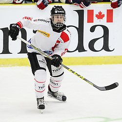 COBOURG, - Dec 16, 2015 -  Game #7 - United States vs Switzerland at the 2015 World Junior A Challenge at the Cobourg Community Centre, ON. AndrÈ Heim #26 of Team Switzerland follows the play during the first period.(Photo: Tim Bates / OJHL Images)