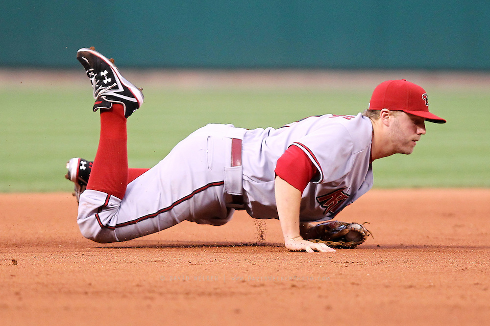 29 June 2010: Mark Reynolds (27) of the Arizona Diamondbacks braces himself after making a diving stop at third base during the Diamondbacks game against the St. Louis Cardinals at Busch Stadium in St. Louis, Missouri.