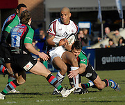 Twickenham, GREAT BRITAIN,  Tigers, Tom VANDELL, tackled low [right De Wet BARRY as left Andy GOMERSALL also moves in to block, during the Guinness Premiership Game, Harlequins [Quins] vs Leicester Tigers, at the Twickenham Stoop [Date]  [Mandatory credit Peter Spurrier/ Intersport Images].