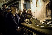 Women are carring a statue rappresentating a death Christ. Verbicaro, Italy. April 18th, 2014. Federico Scoppa