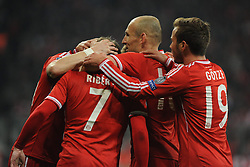 11.03.2014, Allianz Arena, Muenchen, GER, UEFA CL, FC Bayern Muenchen vs FC Arsenal, Achtelfinale, Rueckspiel, im Bild Die Bayern bejubeln den Torschutzen zum 1:0, ganz links Bastian Schweinsteiger (FC Bayern Muenchen) verdeckt Daneben Franck Ribery (FC Bayern Muenchen), Arjen Robben (FC Bayern Muenchen), Mario Goetze (FC Bayern Muenchen) // during the UEFA Champions League Round of 16, 2nd Leg match between FC Bayern Munich and Arsenal FC at the Allianz Arena in Muenchen, Germany on 2014/03/11. EXPA Pictures © 2014, PhotoCredit: EXPA/ Eibner-Pressefoto/ Stuetzle<br /> <br /> *****ATTENTION - OUT of GER*****