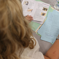Courtney Hood and other new teachers to the Tupelo Public School District take a quick test on workplace safety as they go through an oriendtation class at rankin Elemenatry School on Wednesday.