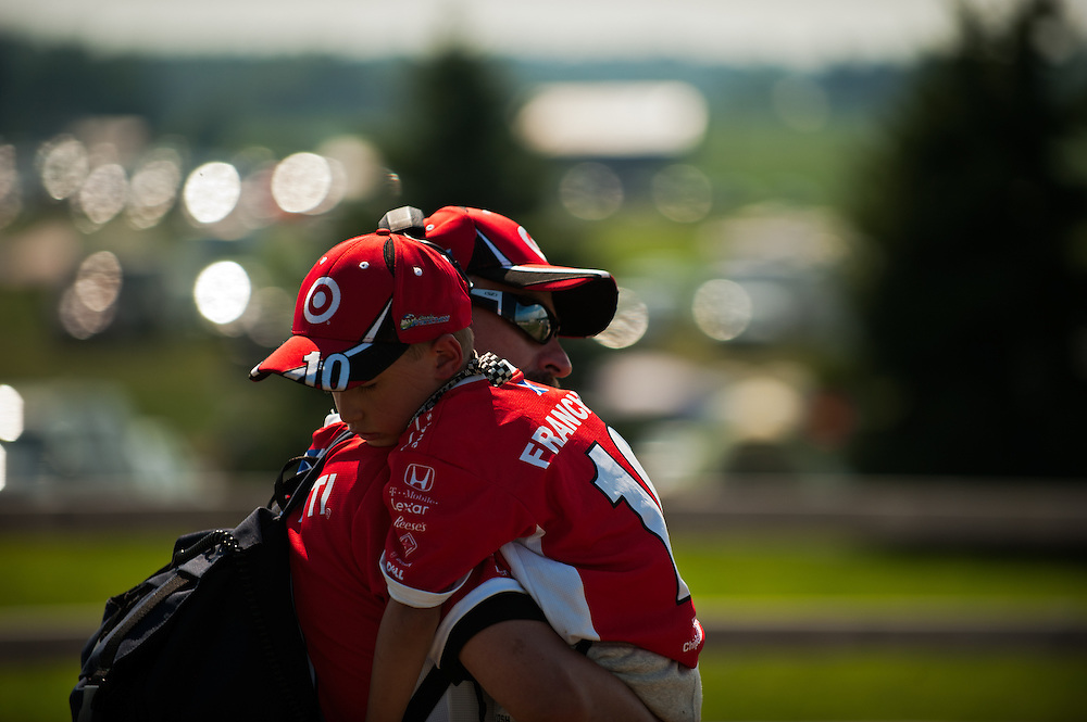 7 August, 2011; Lexington, OH, USA;Exhausted youg boy sleeps in his fathers arms while walking during the Honda Indy 200, IZOD Indycar Series RD13;  Mandatory Credit: Scott LePage-MotorRacingPhoto    © 2011 Scott LePage  http://MotorRacingPhoto.com