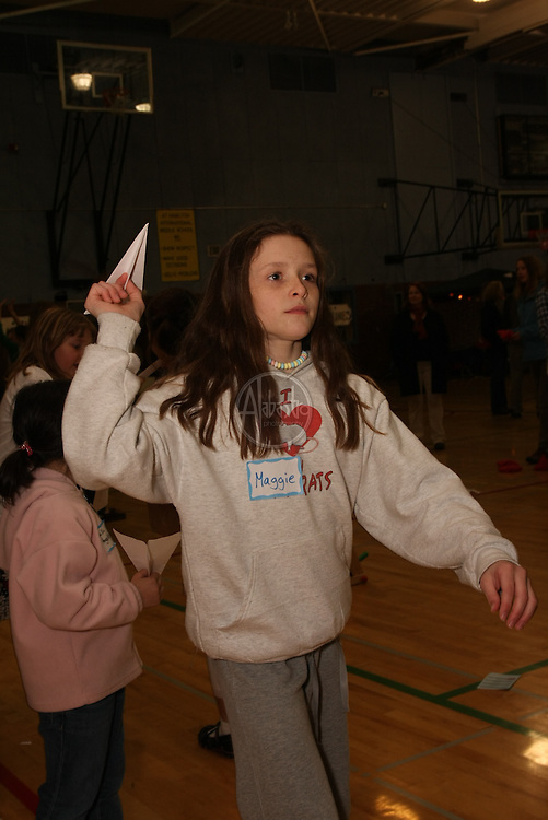Paper airplane challenge at HIMS Carnival Night 2010 - 6th grader Maggie
