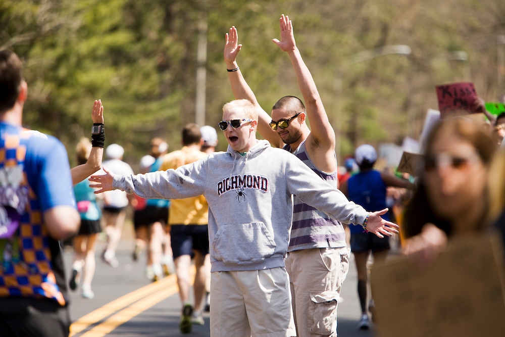 college dudes on the course at Wellesley College near the midpoint of race cheering the runners as they pass