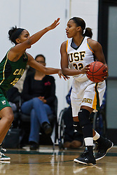 Nov 16, 2011; San Francisco CA, USA;  San Francisco Lady Dons guard Vania Singleterry (32) is defended by Cal Poly Mustangs forward Brittany Woodard (32) during the first half at War Memorial Gym.  Cal Poly defeated San Francisco 80-66. Mandatory Credit: Jason O. Watson-US PRESSWIRE