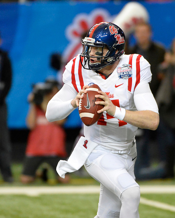 Mississippi Rebels quarterback Bo Wallace (14) rolls out to pass in the Ole Miss vs. TCU Chick-fil-A Peach Bowl football game at the Georgia Dome on December 31, 2014. David Tulis / Abell Images for the Chick-fil-A Bowl