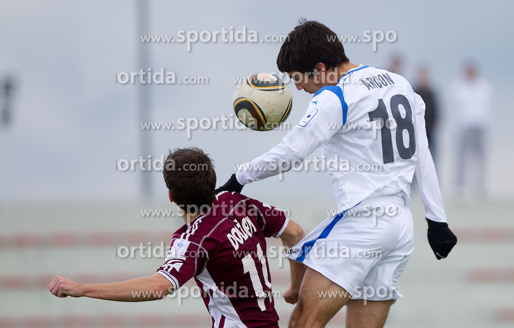 Rok Dolzan of Triglav vs Sandi Arcon of Gorica  during football match between NK Triglav Gorenjska and NK HIT Gorica in 17th Round of PrvaLiga, on November 14, 2010 in Sports center Kranj, Kranj, Slovenia. Triglav defeated Gorica 2-0.  (Photo By Vid Ponikvar / Sportida.com)