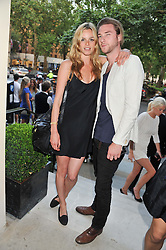 NATASHA GILBERT and SAM PARKER at the launch of Hideaways House at Morton's Club, Berkeley Square, London on 25th July 2012.