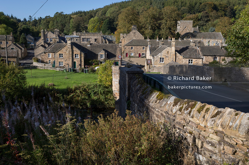 The Northumbrian village of Blanchland, on 29th September 2017, in Blanchland, Northumberland, England. Blanchland village got its name from the white habits worn by monks of the Premonstratensian order who founded Blanchland Abbey. The population of the Civil Parish at the 2011 census was 135. Blanchland was formed out of the medieval Blanchland Abbey property by Nathaniel Crew, 3rd Baron Crew, the Bishop of Durham, 1674-1722. It is a conservation village, largely built of stone from the remains of the 12th-century Abbey. It features picturesque houses, set against a backdrop of deep woods and open moors. Set beside the river in a wooded section of the Derwent valley, Blanchland is an attractive small village in the North Pennines Area of Outstanding Natural Beauty.