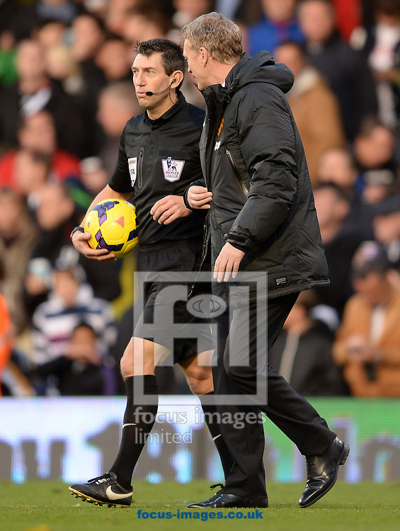 Picture by Andrew Timms/Focus Images Ltd +44 7917 236526<br /> 02/11/2013<br /> Manager of Manchester United David Moyes talking to Referee Lee Probert during the Barclays Premier League match against Fulham at Craven Cottage, London.