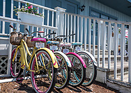 Colorful women's bicycles lined up and parked at Hungry Town Tours in Beaufort, North Carolina, on the Crystal Coast.  Hungry Town Tours offers bicycle tours of the historic town and waterfront including culinary tours.