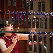 "February 18, 2012 - New York, NY : .Kyoko Kato, on hokoyo, performs Maki Ishii's 'Chronology 1200' (1994) during ""Resonances of the Kugo,"" part of the 2012 New York Music From Japan Festival, at Merkin Concert Hall on Saturday. .CREDIT: Karsten Moran for The New York Times"