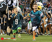 Aug 21, 2014; Philadelphia, PA, USA; Two young fans lead the Philadelphia Eagles out of the tunnel to start a game against the Pittsburgh Steelers at Lincoln Financial Field. Mandatory Credit: Bill Streicher-USA TODAY Sports