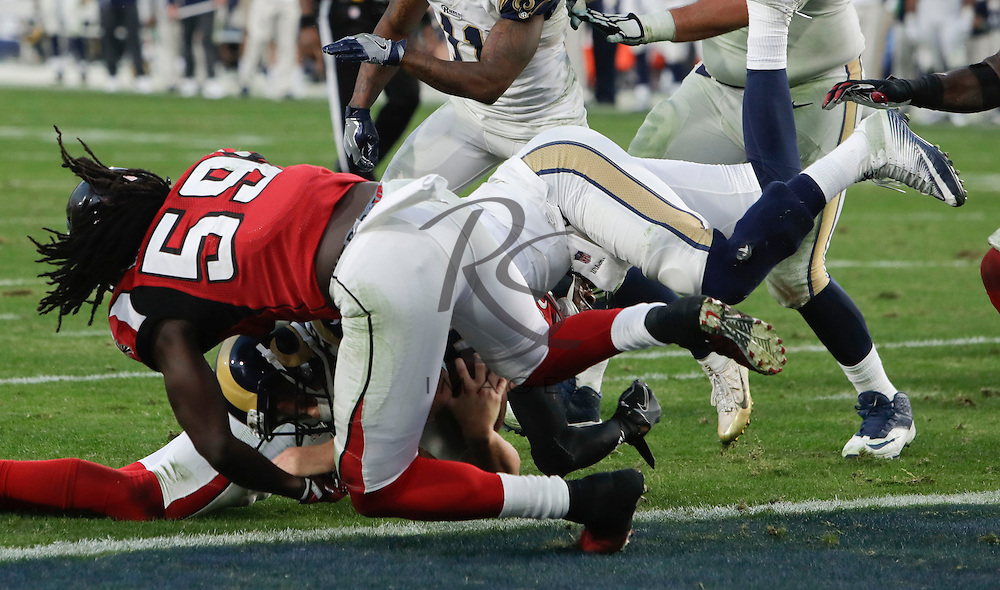 Los Angeles Rams quarterback Jared Goff scores past Atlanta Falcons outside linebacker De'Vondre Campbell during the second half of an NFL football game Sunday, Dec. 11, 2016, in Los Angeles. (AP Photo/Rick Scuteri)