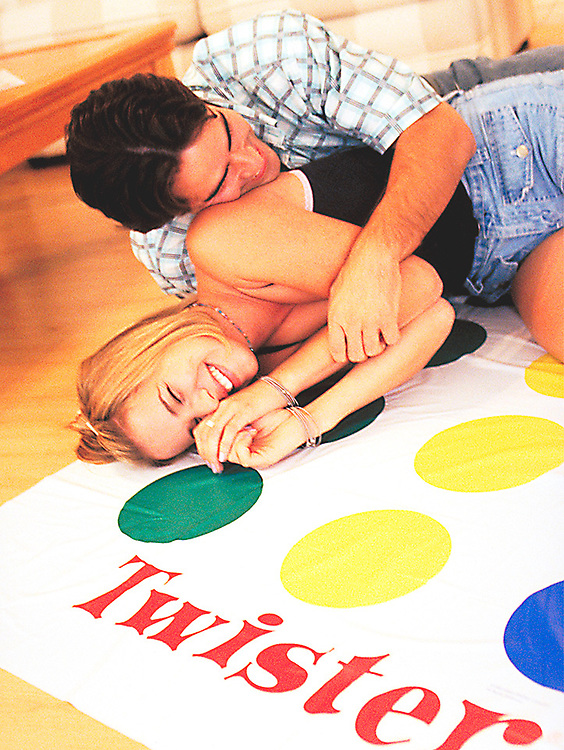 Romantic couple playing twister, embrace
