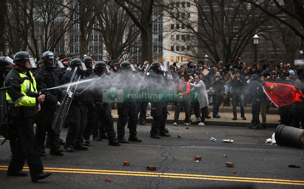 January 20, 2017 - Washington, DC, U.S - Police in riot gear use pepper spray on the crowd of anti-Trump protesters after a limousine was set on fire during clashes on President Donald Trump's inauguration day in Washington, D.C., on Jan. 20, 2017. (Credit Image: © Carol Guzy via ZUMA Wire)
