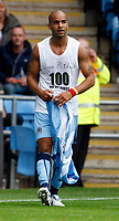 Photo: Richard Lane/Richard Lane Photography. Coventry City v Norwich City. Coca-Cola Championship. 09/08/2008. Coventry's Leon McKenzie shows the writing on his vest after removing his playing shirt during his goal celebration.