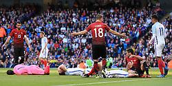 England's John Stones and Gary Cahill lie on the floor with head injuries - Mandatory byline: Matt McNulty/JMP - 07966386802 - 22/05/2016 - FOOTBALL - Etihad Stadium -Manchester,England - England v Turkey - International Friendly