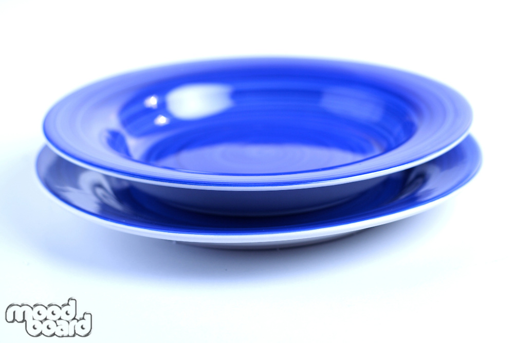 Blue dishes on white background