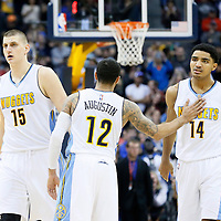 06 March 2016: Denver Nuggets guard D.J. Augustin (12) congratulates Denver Nuggets guard Gary Harris (14) and Denver Nuggets center Nikola Jokic (15) during the Denver Nuggets 116-114 overtime victory over the Dallas Mavericks, at the Pepsi Center, Denver, Colorado, USA.