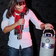 NLD/Amsterdam/20121129- Uitreiking Red's Hot Women Awards 2012, Guenevere Prawiroatmodjo met fles stikstof