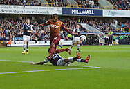 Carlos Edwards of Millwall makes a last ditch tackle on Kyel Reid of Bradford City  to prevent a good chance of scoring during the Sky Bet League 1 Playoff Semi-final Leg Two at The Den, London<br /> Picture by Alan Stanford/Focus Images Ltd +44 7915 056117<br /> 20/05/2016