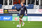 AFC Wimbledon Midfielder Mitchell Pinnock (11) warms-up ahead of the EFL Sky Bet League 1 match between Luton Town and AFC Wimbledon at Kenilworth Road, Luton, England on 23 April 2019.
