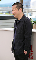 Director Jia Zhangke.at the Tian Zhu Ding (A Touch Of Sin) film photocall at the Cannes Film Festival 17th May 2013