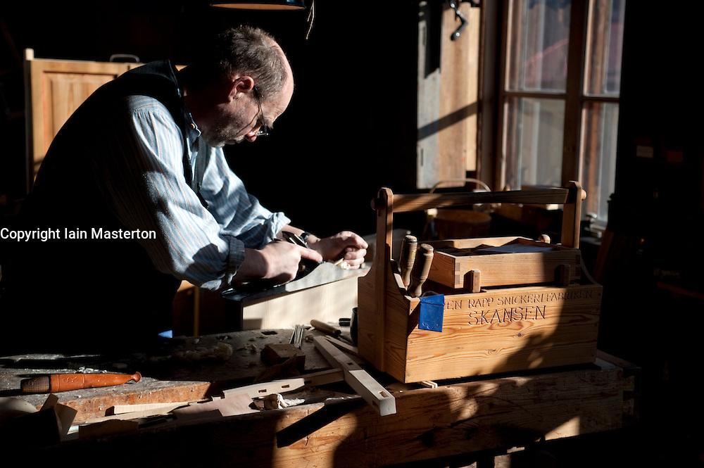 Craftsman carpenter making furniture at Skansen open air museum in Stockholm Sweden 2009