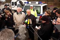 03 JAN 2005, LUDWIGSFELDE/GERMANY:<br /> Ernst Vorrath (Mi L), Praesident des Bundesamtes fuer Gueterverkehr, und Manfred Stolpe (Mi R), SPD, Bundesverkehrsminister, geben ein Pressestatement, waehrend dem besuch einer Mautkontrolle, Parkplatz Fresdorfer Heide<br /> IMAGE: 20050103-01-014<br /> KEYWORDS: Bundesamt f&uuml;r G&uuml;terverkehr, LKW Maut, Journalisten, Mikrofon, microphone<br /> BAG