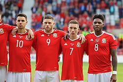 WREXHAM, WALES - Friday, September 2, 2016: Wales' Thomas O'Sullivan, Wesley Burns, Harry Wilson and Ellis Harrison line-up for the national anthem before the UEFA Under-21 Championship Qualifying Group 5 match against Denmark at the Racecourse Ground. (Pic by Paul Greenwood/Propaganda)