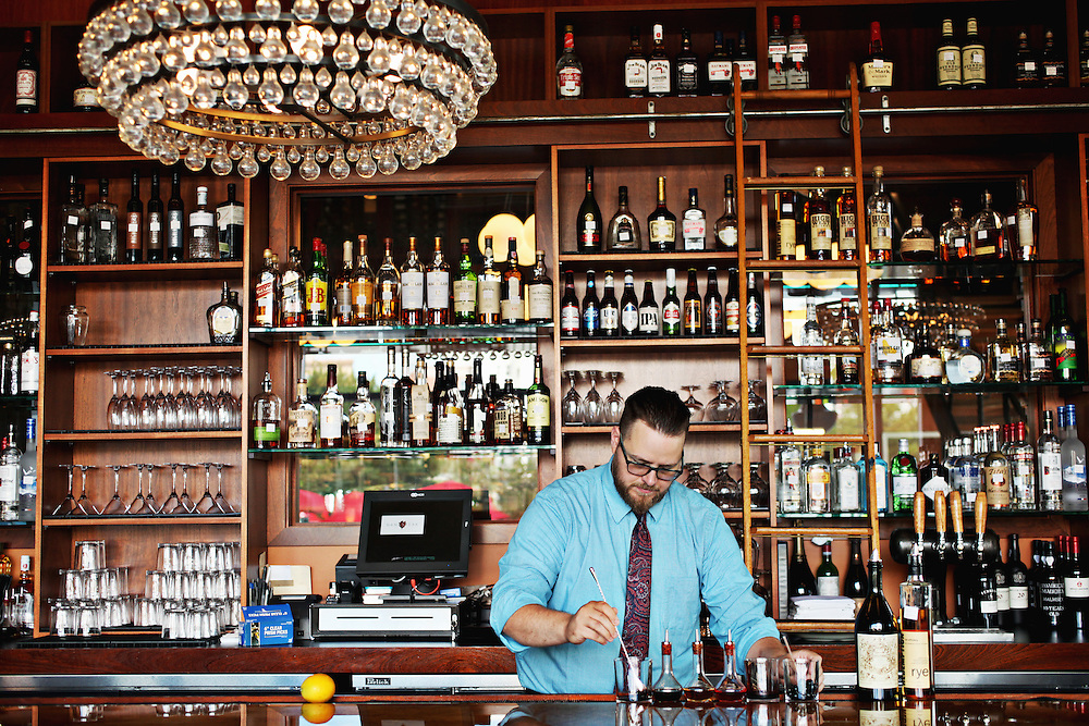 Bar manager and managing partner Brad Weddington of NanaSteak in Durham makes an Old Fashioned at the restaurant's bar.