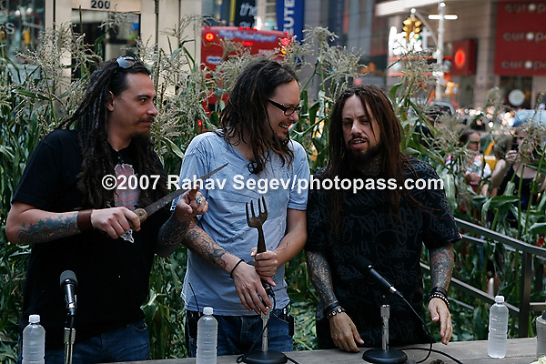 Korn holding a press conference at the armed . forces recruiting station in times square at 43rd st on July 31, 2007. .They were promoting their new untitled cd release as well as The Family Values Tour which kicked off last week as well as discussing their efforts to use alternative fuels during their tour and promote the show as a green event. .Left to right .James Christian 'Munky' Shaffer.Jonathan Davis.Fieldy